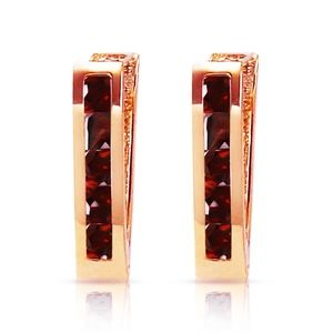 14K. SOLID GOLD OVAL HUGGIE EARRING WITH GARNETS